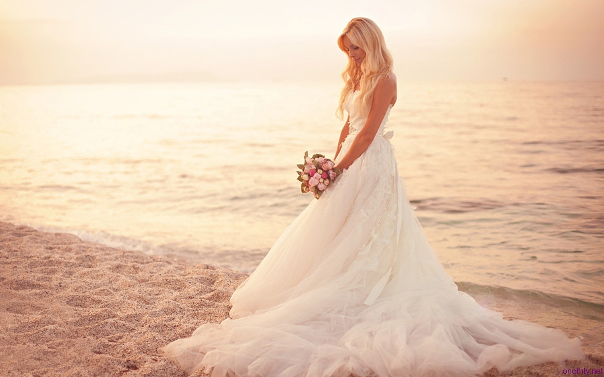 bride on beach after a wedding